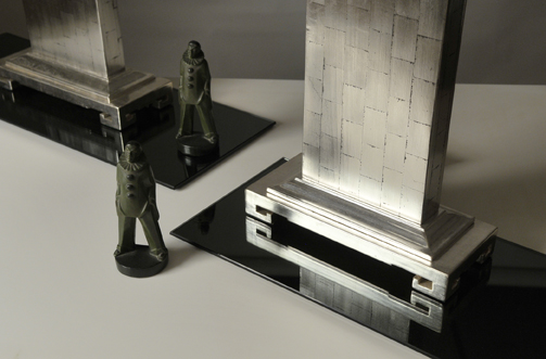 detail of silver and palladiium leaf lamp bases with carved green bookends